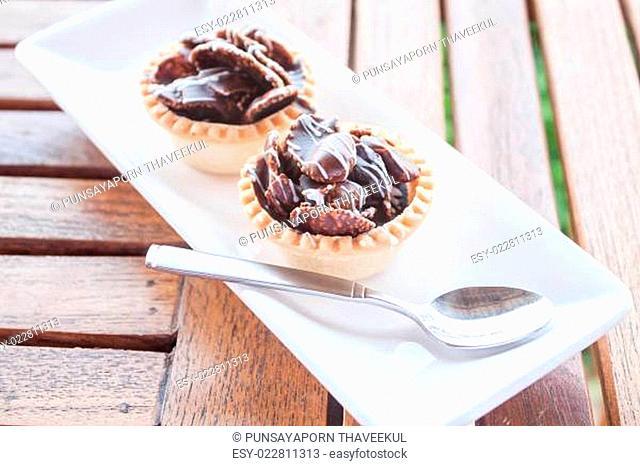 Chocolate crispy tarts on white plate