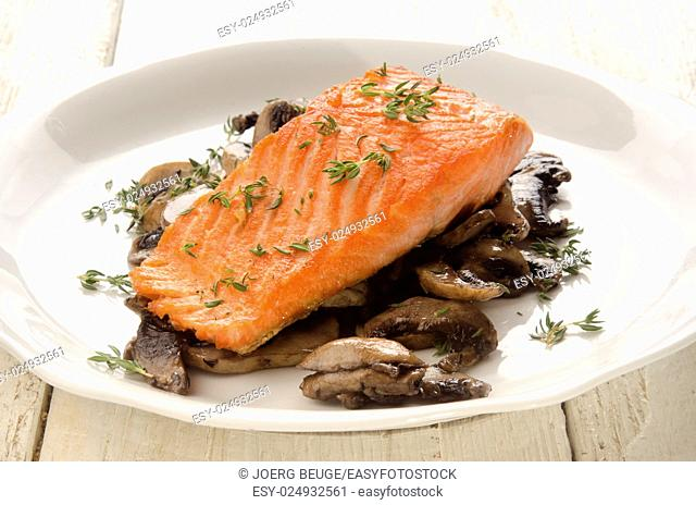 grilled salmon fillet with fresh thyme and mushroom