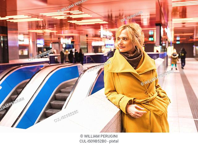 Woman waiting in underground station