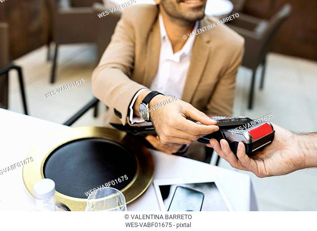 Woman paying with credit card in a restaurant