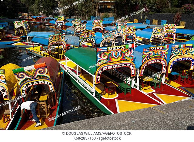 Boats, called Trajineras at the embarcadero in Xochimilco, Mexico City, Mexico