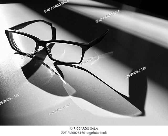 Glasses in the Light and Shadows. .