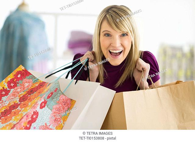 Portrait of woman holding shopping bags