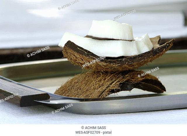 Fresh coconut slices on plate