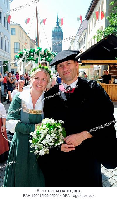15 June 2019, Saxony-Anhalt, Wittenberg: Ramona and Marco Glaß, actors of the Luther couple, walk through the city centre during a procession