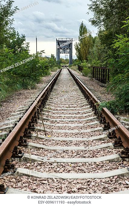 railway track near Chernobyl Nuclear Power Plant in Zone of Alienation, Ukraine