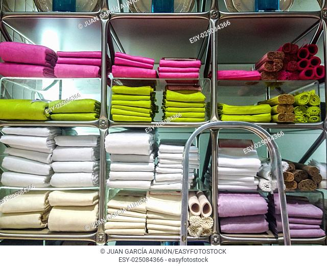 Towels, mats, robes and other home bath wear on shelves made of Egyptian Cotton