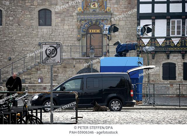 A police sniffer dogs lies on the street next to a black van on the square near the town hall inBraunschweig, Germany, 15 February 2015