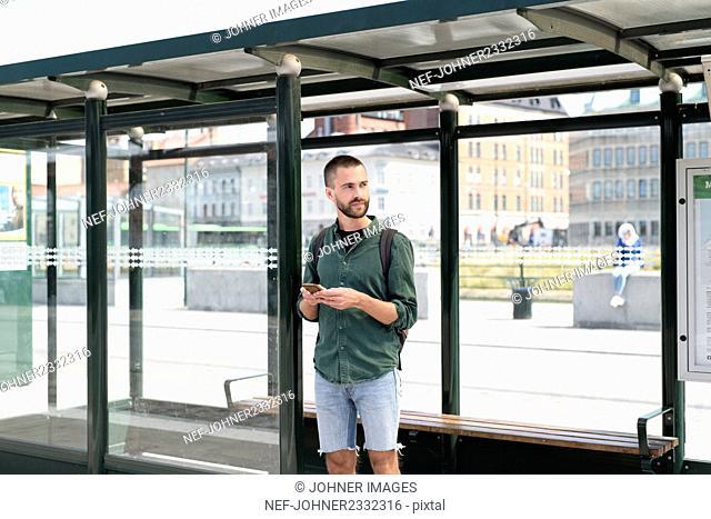 Man waiting on bus stop