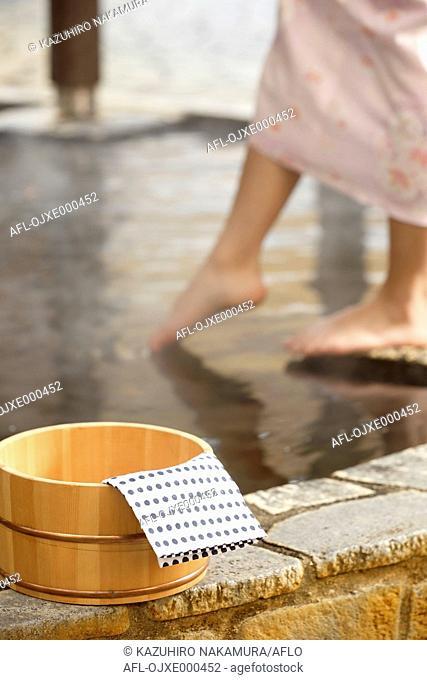 Japanese woman bathing at traditional hot spring, Tokyo, Japan