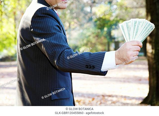 Businessman holding currency notes