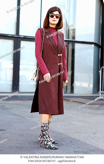 Blogger Valentina Siragusa posing outside the Aujourlejour runway show during Milan Fashion Week - Sept 24, 2017 - Photo: Runway Manhattan/Valentina Ranieri...