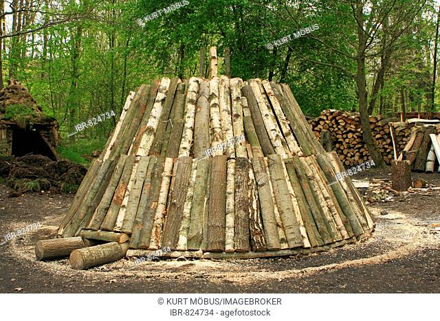 Woodpile, newly erected for charcoal production, yet uncovered, Hessenpark Museum, Hesse, Germany, Europe