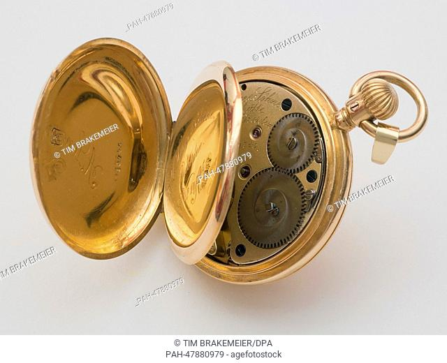 A golden lady's pocket watch from the second half of the 19th century of watchmaker 'Lange und Soehne (Lange and Sons) is on display on a table in Eichwalde
