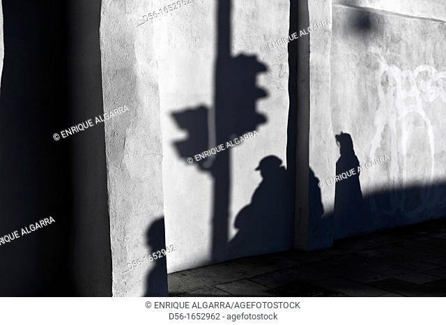 Semaphore, pedestrians and shadows, Valencia, Spain