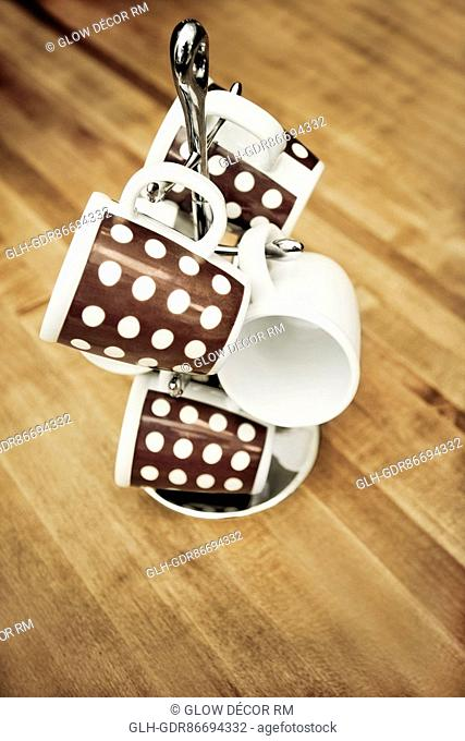 Close-up of tea cups on a tea cup stand