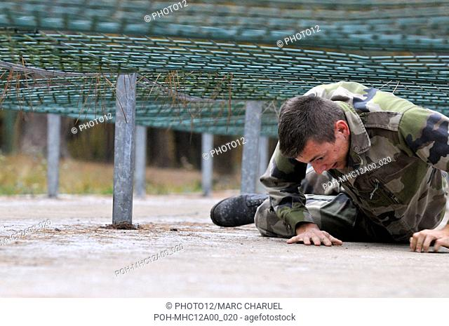 Military student exercising on the obstacles of the assault course November 2, 2010
