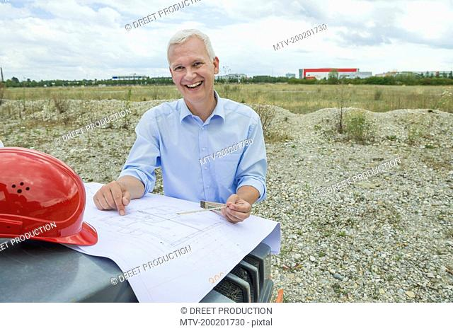 Architect checking construction plan