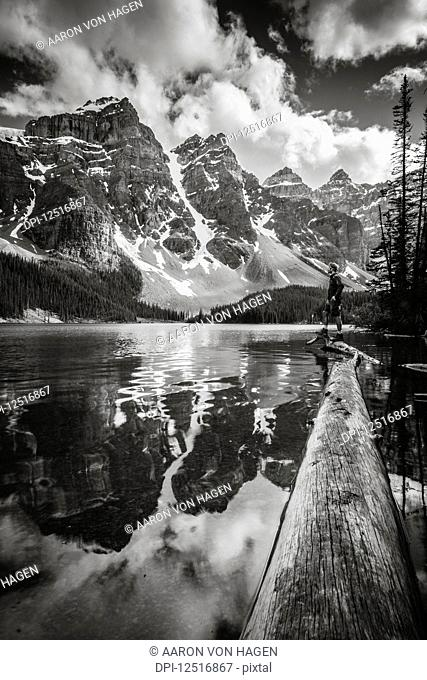 Rugged peaks of the Rocky Mountains reflected in a lake in Banff National Park; Alberta, Canada