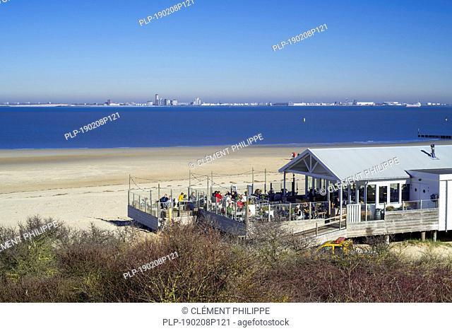 Skyline of the city Vlissingen and beach restaurant pavilion near Breskens along the Western Scheldt / Westerschelde, Zeeland, the Netherlands
