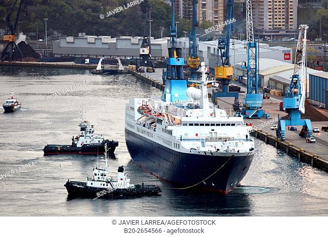 Berthing. Tugboat and cruise liner. Passenger ship. Tug maneuvers. Pasaia Port. Gipuzkoa. Basque Country. Spain. Europe