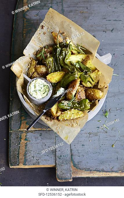 Pimentos with potato wedges and herb butter