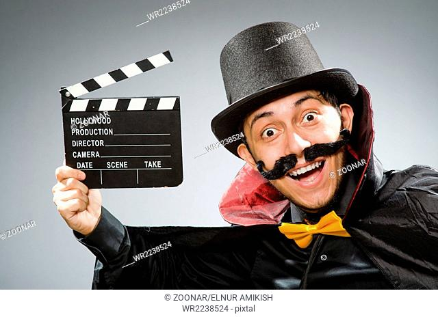 The funny man with movie clapboard