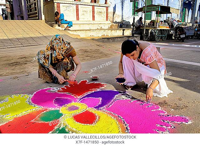 women making rangoli,Gangaur festival,pushkar, Rajasthan, india
