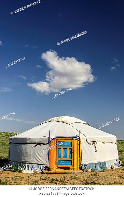 Yurt and blue sky with clouds in the Gobi desert, Mongolia