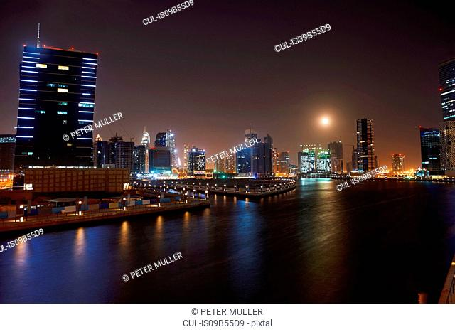 Cityscape at night showing Dubai Canal, Dubai, UAE