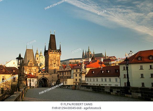 Charles Bridge (Karluv Most) looking towards Mala Strana (Lesser Quarter), Prague Castle and St. Vitus Cathedral at sunrise, Vltava River, Prague