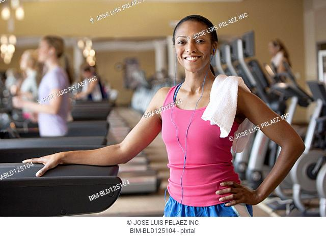 African American woman smiling in gym