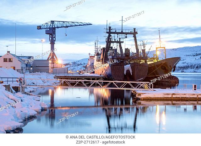 Kirkenes is a town in Sor Varanger municipality in Finnmark county, Norway. The harbor at dusk on March 26, 2016