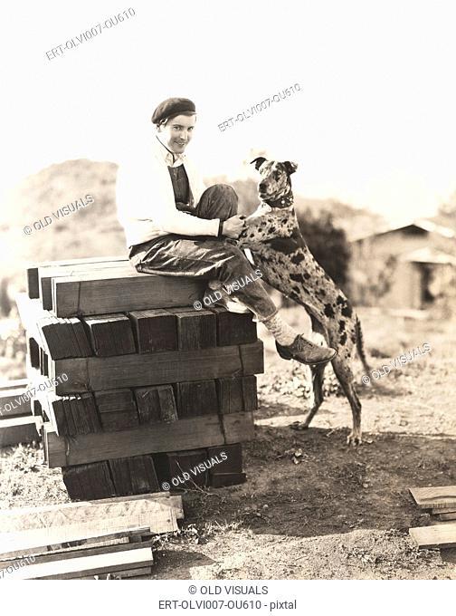 A man and his dog take a break (OLVI007-OU610-F)