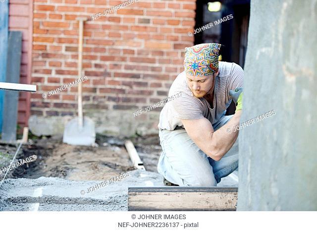 Worker leveling concrete floor