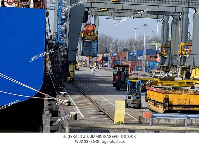 Rotterdam, Netherlands 2018. Freight being unloaded from a cargo ship and stored on the pier waiting for relocation
