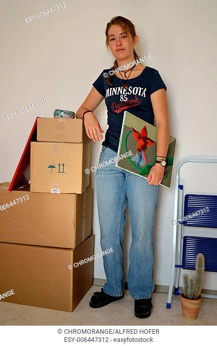 Young woman with packed boxes ready for the move