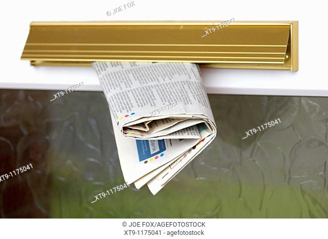 local newspaper delivery stuck in the letterbox in northern ireland uk