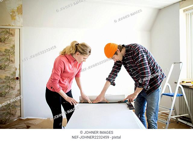 Couple doing DIY in garden