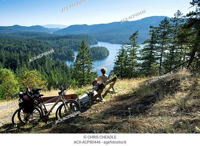 Elevated view of woman over Ruby Lake, Sunshine Coast, British Columbia, Canada