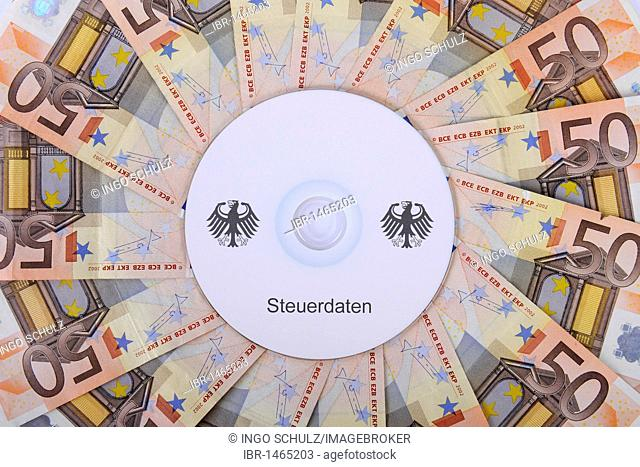 CD, bills, 50 euro notes, bank notes, symbolic image for illegal trade with tax data, customer data, banking information, tax evasion, black money