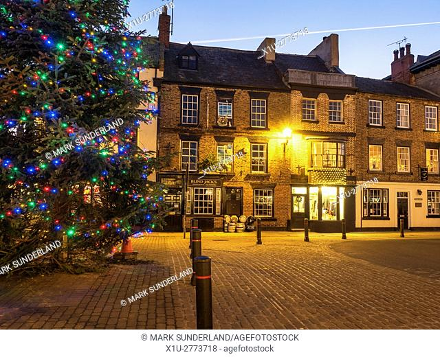 Christmas Tree and Blind Jacks Pub in the Market Place at Christmas Knaresborough North Yorkshire England