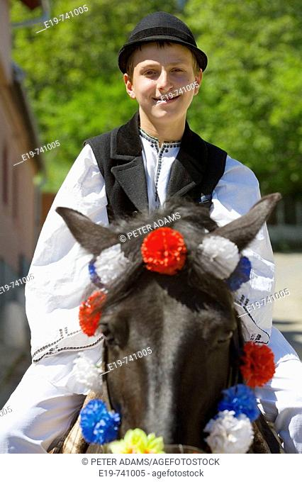 Man in traditional costume on horse near Sibiu, Transylvania, Romania