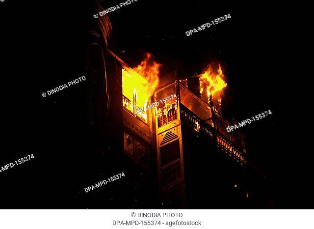 Taj Mahal hotel engulfed in fire during terrorist attack by Deccan Mujahideen  ; Bombay Mumbai ; Maharashtra ; India 26-November-2008