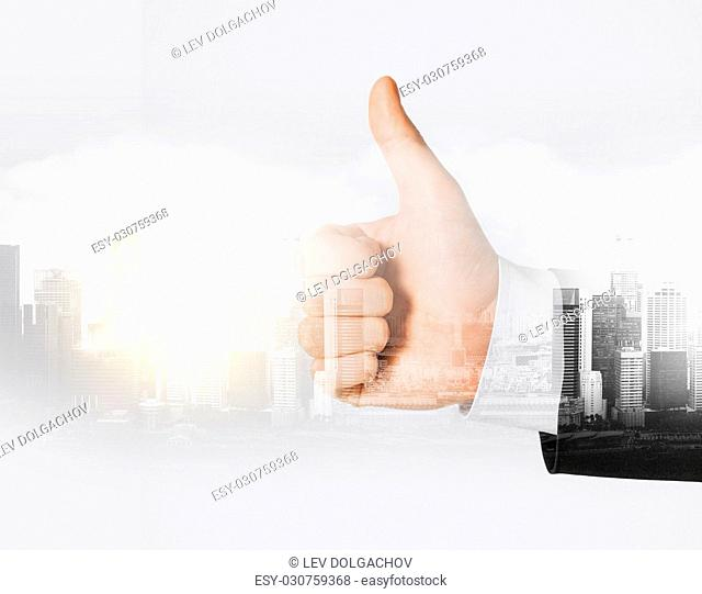 business, gesture and people concept - close up of businessman hand showing thumbs up over city with double exposure