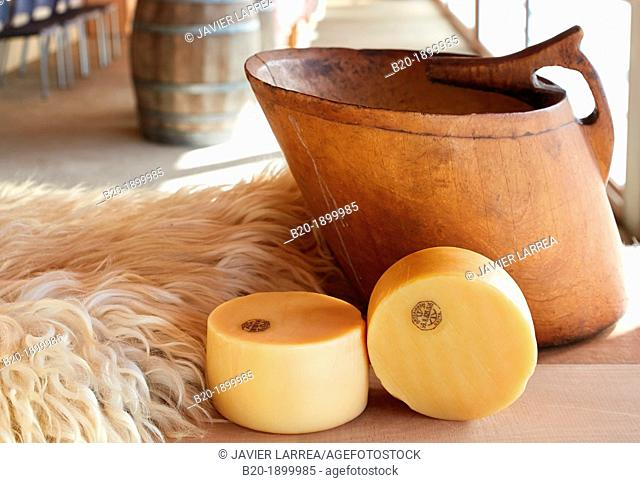 Cheese with denomination of origin Idiazabal  Kaiku, Container for collecting milk from sheep and used for the preparation of curds and cheese  Cheese factory...