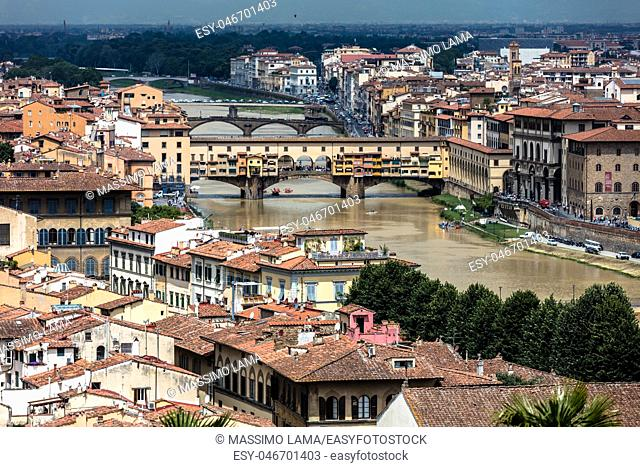 View of historical medieval bridge on the Arno river, ponte Vecchio, Florence, Italy