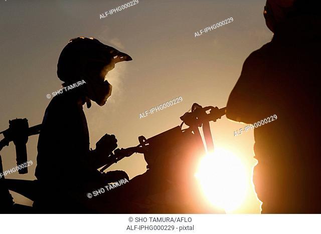 Motocross bikers on dirt track