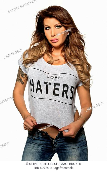 Woman, blonde poses with shirt HATERS, fashion, portrait, look into the camera