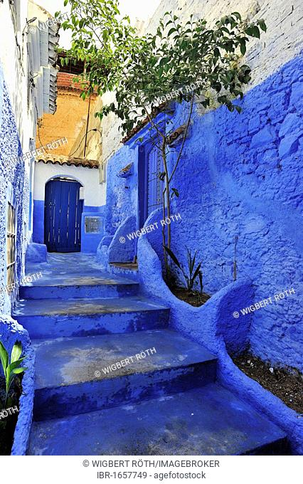 Narrow alleyway with steps in Chefchaouen, Rif Mountains, Morocco, Africa